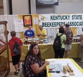 Honey table and candlemaking at the 2015 Honey Booth