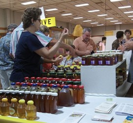 Honey table at the 2015 Honey Booth